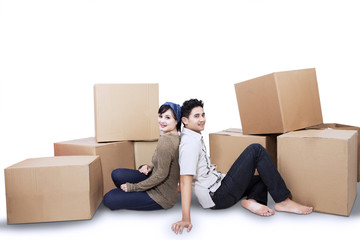 Couple relaxing moving into a new home isolated