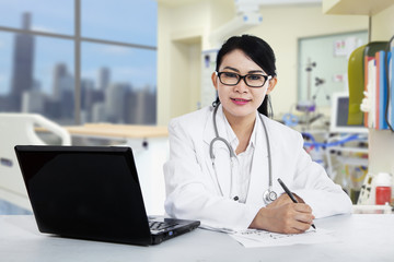 Female doctor writing prescription