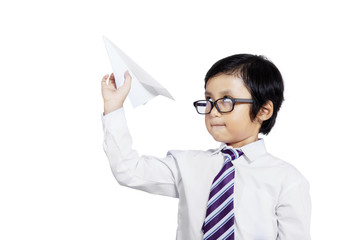 Little businessman holding paper aircraft