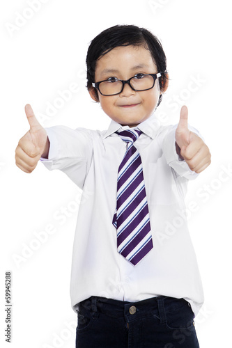 Little businessman shows OK gesture