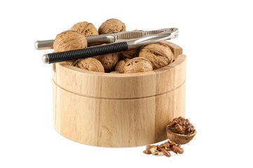 Walnuts in utensil with nutcracker