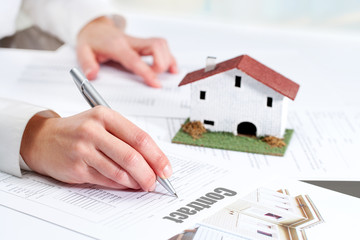 Hand reviewing housing contract.