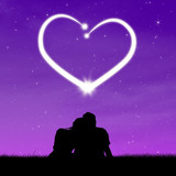Silhouette couple looking at heart