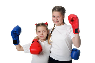 Beautiful young little girls  wearing a pair of boxing gloves.