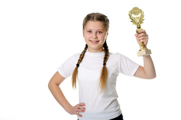 Proud young girl holding her trophy