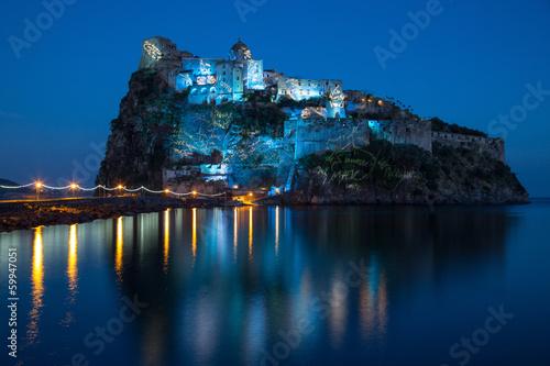Leinwanddruck Bild aragonese castle in the night
