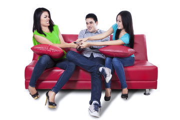 Three people fighting for remote control