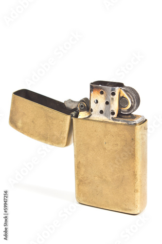 Golden vintage lighter isolated on white