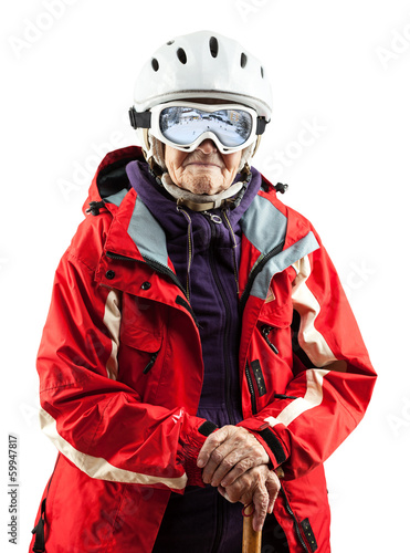 Senior woman in ski jacket and helmet over white . With path.