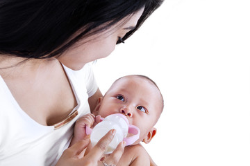 Young mother feeding her baby isolated