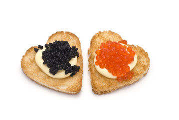 ... : Two Heart-Shaped Toasts with Red and Black Caviar on White Sauce
