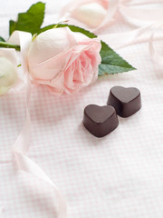 Pink rose with chocolate candy