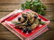 roasted rabbit with herbs and black olives, selective focus
