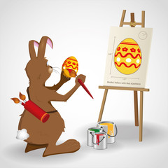 Easter bunny rabbit painting an egg as given on a blueprint