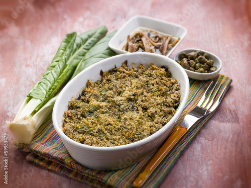 gratin of swiss chard anchovies and capers, selective focus