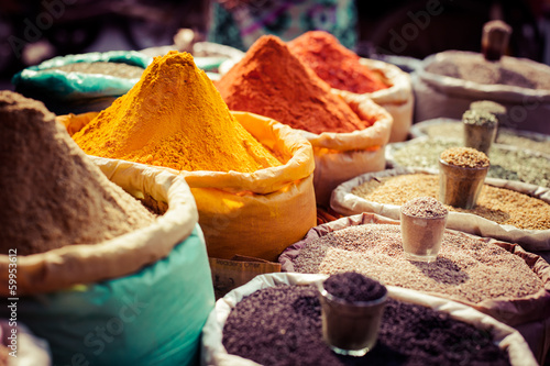 Plexiglas Asia land Indian colored spices at local market.