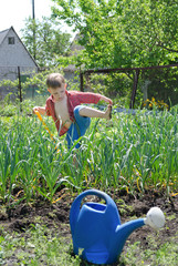 Young boy working in the veggie garden