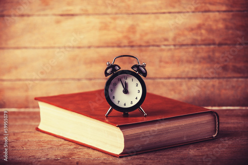 Alarm clock and book.