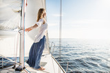 Fototapety woman staying on sailboat