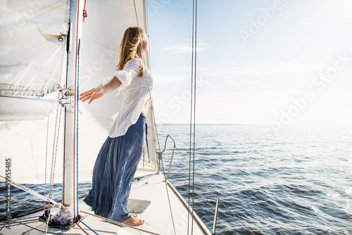 Fototapeta woman staying on sailboat