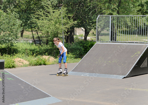 Teenage girl skating in a skate park