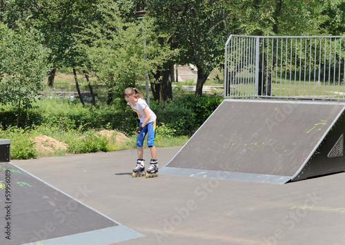 Teenage girl skating in a skate park