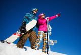 Couple with snowboards