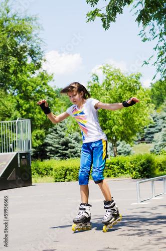 Pretty teenage girl skating in a skate park