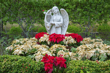 White marble statue of angel in garden