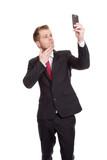 Businessman taking a selfie poster