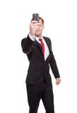 Handsome businessman taking a selfie poster