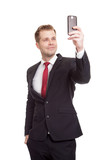 Handsome businessman taking a selfie