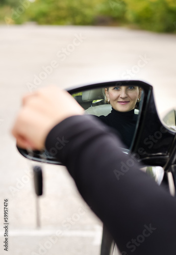 Attractive woman driver with her car keys