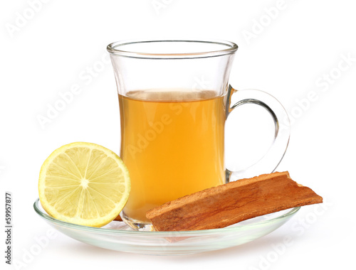 Cup of herbal tea with lemon and cinnamon bark