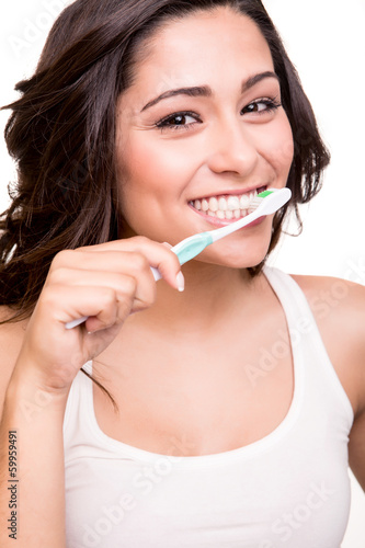 Woman holding a tooth brush