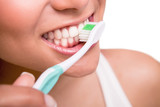 Woman holding a tooth brush - 59959642