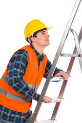 Construction worker in reflective clothing climbing a ladder.