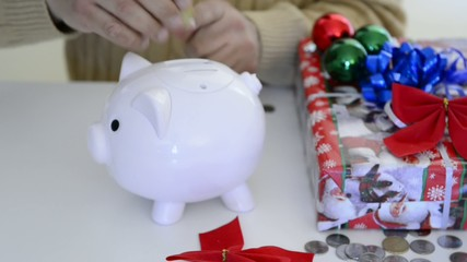 Man saving money for Christmas gifts and expenditures