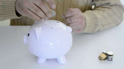 Man saving money in a piggybank