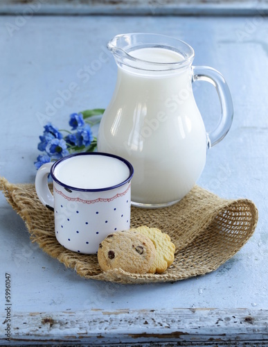Leinwandbild Motiv jug with milk on wooden table rustic still life