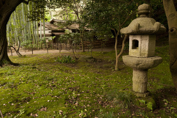 Lantern and traditional house  in japaneese garden Sankei-en