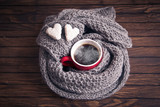 A cup of coffee in a scarf, top view