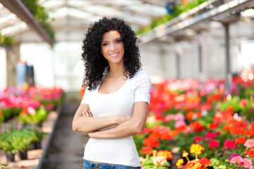 Beautiful woman in a floral environment