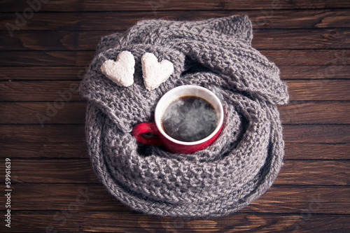 canvas print picture A cup of coffee in a scarf, top view