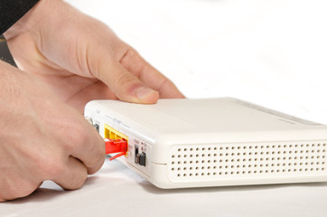 Hand in the foreground while connecting a router