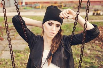 gentle portrait of a beautiful girl on a swing