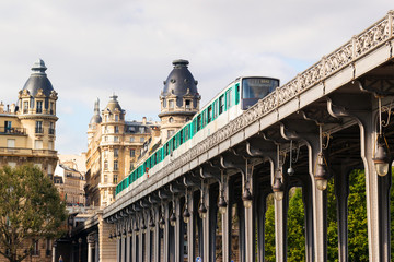 Metro runs high between buildings in Paris