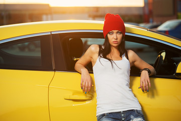 Fashionable punk woman standing at the car