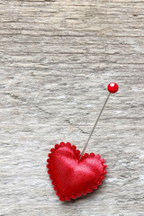 Red heart with cupid arrow on wooden background. Copy space