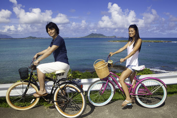 japanese couple on bikes